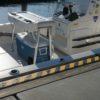 Hazard strips installed at a dock